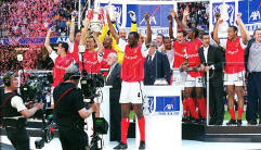 Arsenal lifting the cup in 2002